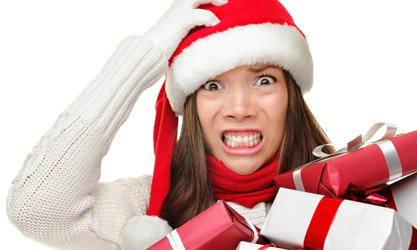 Christmas stress - busy woman wearing santa hat stressing for ch_518910