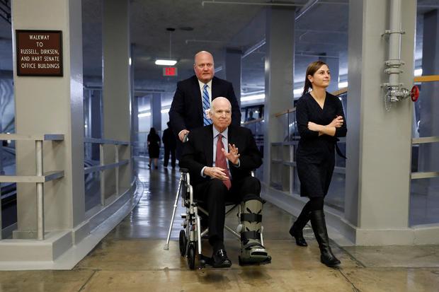 Sen. John McCain heads to the Senate floor ahead of votes on Capitol Hill in Washington_528016