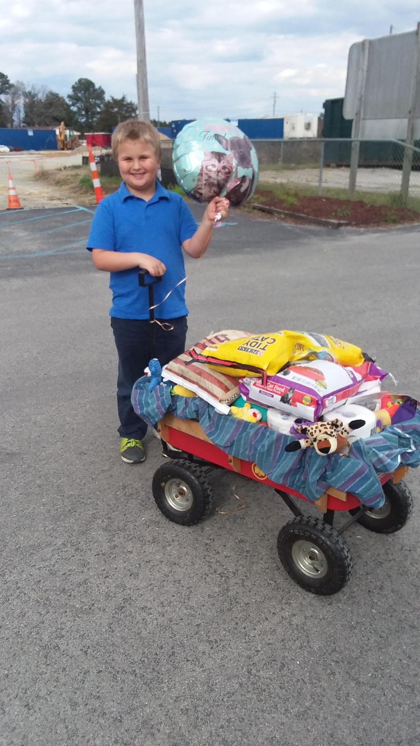 Bryson Woolverton Donates Pet Supplies_1552945063920.jpg.jpg
