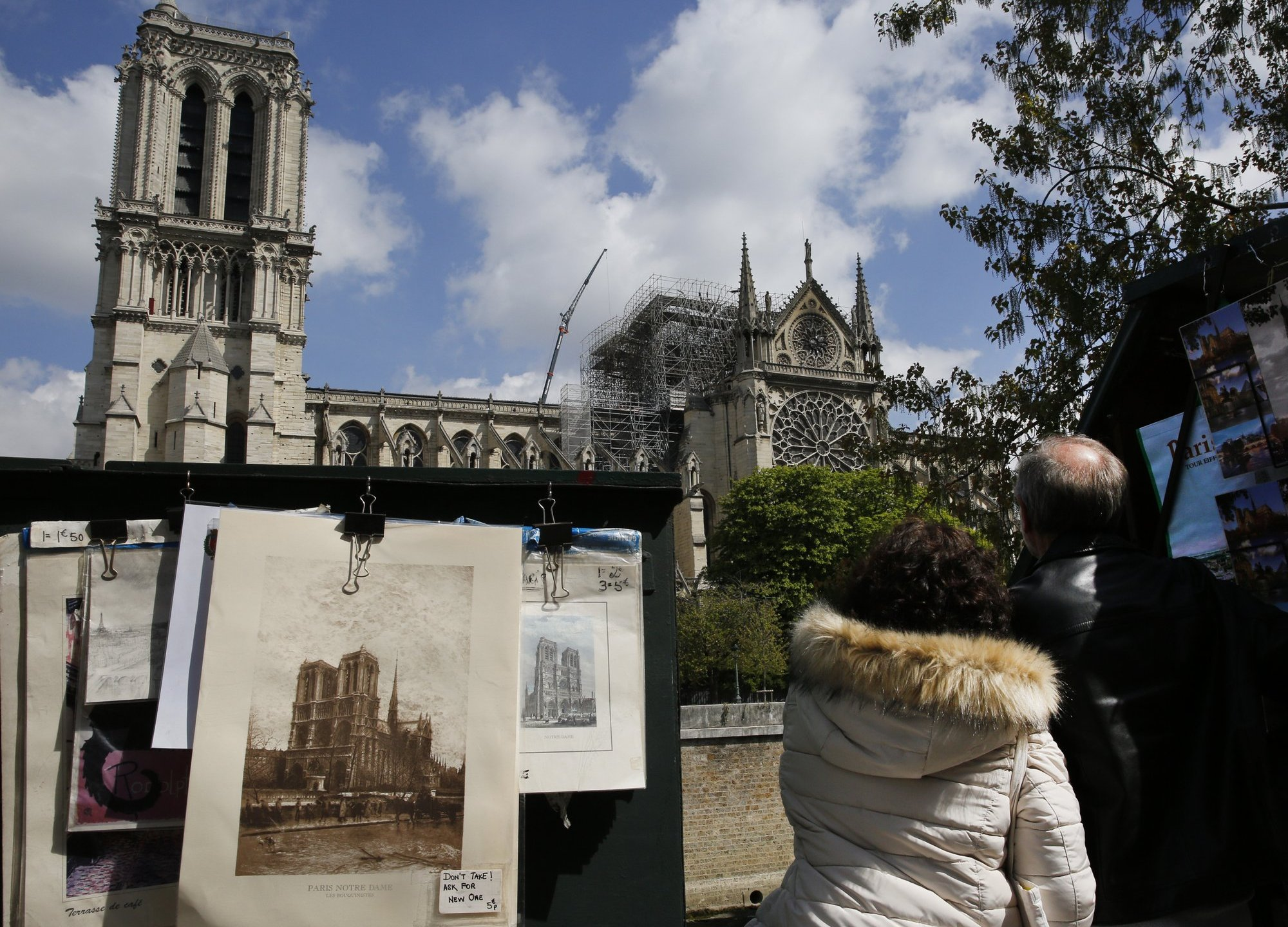 Merchants Outside Burned Notre Dame Cathedral