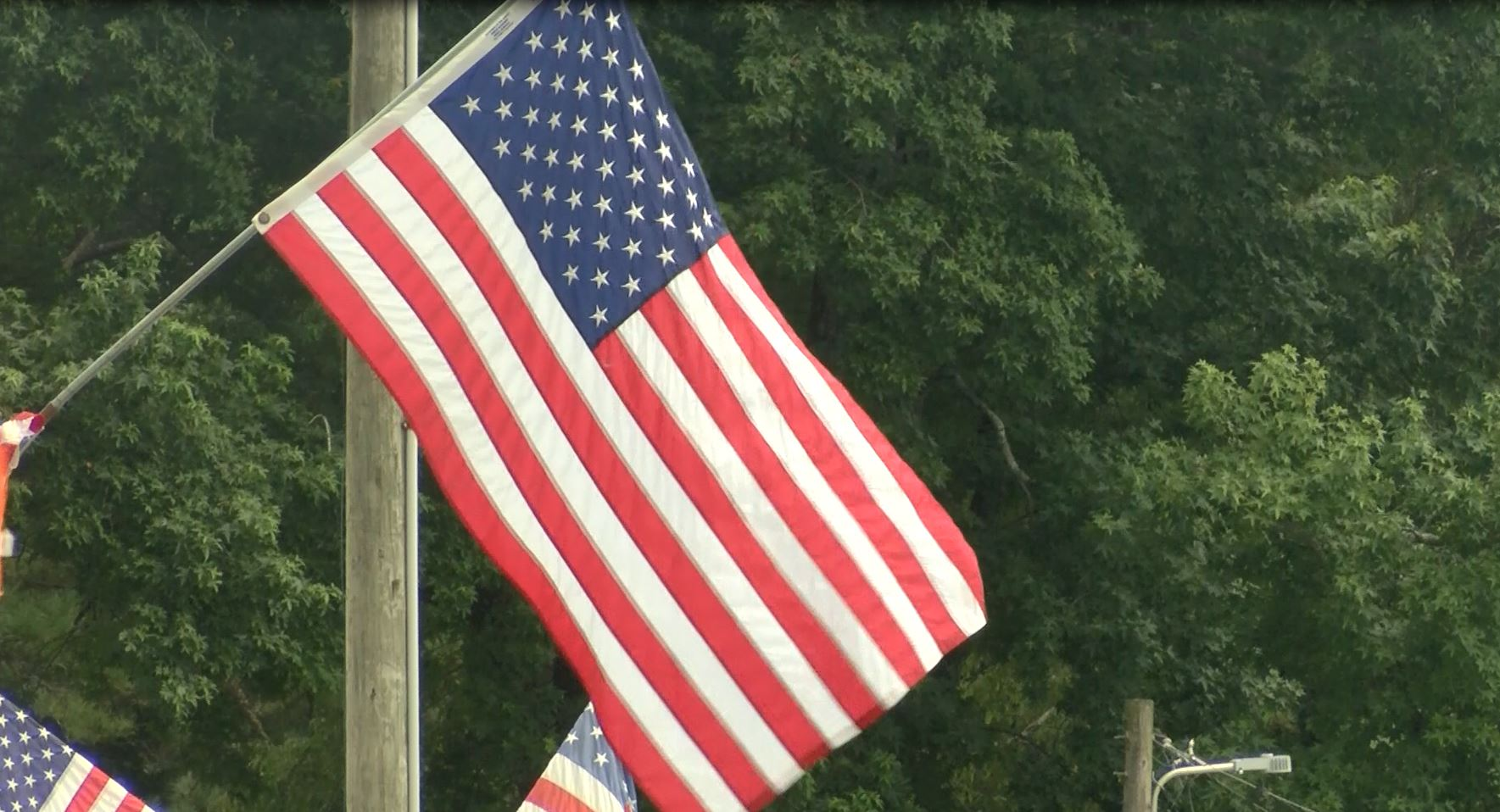 American Flag Hanging From Pole