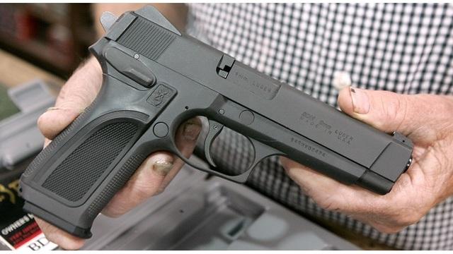 Man Holds Handgun