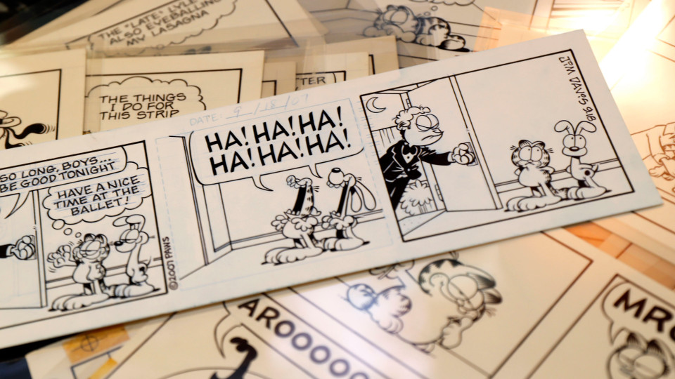 In this Monday, Nov. 18, 2019 photo, Heritage Auctions displays some of the Garfield comic artwork drawn by creator Jim Davis in Dallas. Thousands of the comics drawn by Davis are going up for auction. (AP Photo/LM Otero)